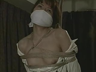 Squirming Damsel, roped and gagged
