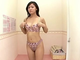 Shy housewife trying out sexy lingerie