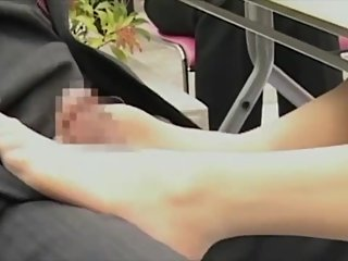 Japanese office lady footjob under table