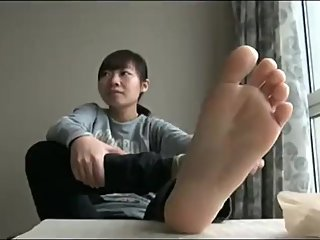 Japanese Removes Stockings To Bare Feet
