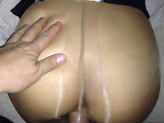 man in stocking fucks his pantyhose wife doggy style